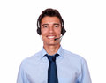 Young hispanic businessman speaking on headphones Royalty Free Stock Photo