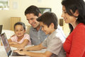Young Hispanic Family Using Computer At Home Royalty Free Stock Photo