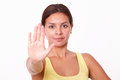 Young hispanic lady with stop gesture portrait of looking at you on isolated studio Royalty Free Stock Photos
