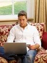 Young Hispanic man shopping online Stock Photos