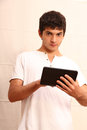 Young hispanic man using tablet pc Stock Photography