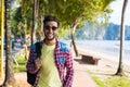 Young Hispanic Man Walking Tropical Beach Sea Holiday Guy Happy Smiling Summer Vacation Royalty Free Stock Photo