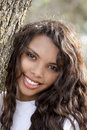 Young hispanic teen girl smiling outdoor portrait Royalty Free Stock Photo