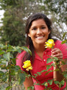 Young Hispanic Teen Girl with Yellow Roses Royalty Free Stock Photo
