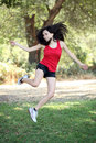 Young hispanic teen woman jumping outdoors Royalty Free Stock Photo