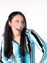 Young Hispanic Woman Surprised Stock Photo