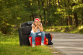 Young hitch-hiker girl Royalty Free Stock Photography
