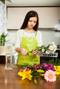 Young housewife doing  bouquet Royalty Free Stock Photo