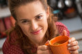 Young housewife drinking tea in kitchen Royalty Free Stock Photo