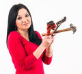 Young housewife look scared some tools before beginning repair Royalty Free Stock Photography