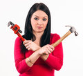 Young housewife look scared some tools before beginning repair Stock Photo