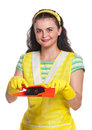 Young housewife with scoop and broom isolated on white background Stock Photography