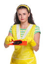 Young housewife with scoop and broom isolated on white background Royalty Free Stock Photos
