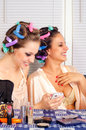Young housewives having good time while beautifying themselves Royalty Free Stock Images