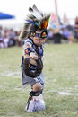 Young indian boy dancing at pow-wow Royalty Free Stock Photo