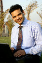 Young indian business man smiling Royalty Free Stock Photos