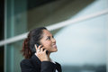 Young Indian business woman using mobile phone. Stock Image