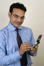 Young indian executive taking a call Stock Photos