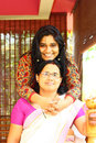 Young Indian Family - Mother and Daughter Hugging Stock Images