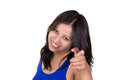 Young indian girl pointing at you with a cheerful smile Stock Photos