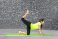 Young Indian girl practising yoga
