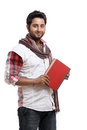 Young indian man posing with book Royalty Free Stock Photography