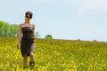 Young inked woman in a wonderful wildflower meadow Stock Photography