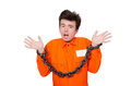 Young inmate with chains isolated on the white Stock Image