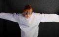 Young insane woman with straitjacket with pilot glasses over dark background Stock Photos