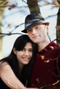 Young interracial couple hugging by lake smiling together Royalty Free Stock Photography