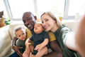 Young interracial family with little children taking selfie. Royalty Free Stock Photo