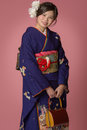 Young japanese girl in kimono a portrait of a beautiful a blue for her coming of age ceremony on her th birthday Royalty Free Stock Images