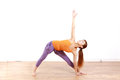 Young japanese woman doing yoga extended triangle pose example shot of by Stock Photography