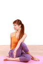 Young Japanese woman doing YOGA plow pose Royalty Free Stock Photo