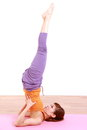 Young Japanese woman doing YOGA shoulder stand Royalty Free Stock Photo