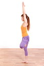 Young japanese woman doing yoga tree pose example shot of by Stock Photography