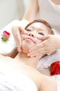 Young Japanese woman receves face massage Royalty Free Stock Photo