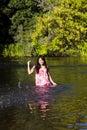 Young Japanese Woman Splashing River Dress Smiling Royalty Free Stock Photo