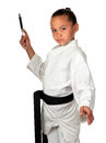 Young karate champ a girl with black belt stands ready to throw a knife Stock Image