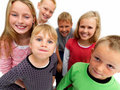 Young kid holdiing his breath with friends Stock Photos