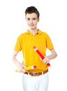 Young kid holding two big colorful pencils cute red and yellow in his hands Royalty Free Stock Image
