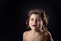 Young kid with humor expression and flying hair Royalty Free Stock Photography