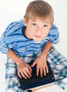 Young kid with laptop looking upwards Stock Photo