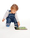 Young kid touching tablet pc Royalty Free Stock Photos