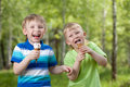 Young kids eating a tasty ice cream outdoor Royalty Free Stock Photos
