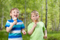 Young kids eating a tasty ice cream outdoor Royalty Free Stock Photo