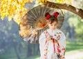 Young kimono girl with traditional umbrella Royalty Free Stock Photo
