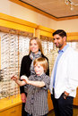 Young lad checking out options for glasses in optimist office Stock Image