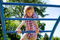 Young lad climbing on playground Royalty Free Stock Photo