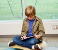 Young lad enjoying tablet Royalty Free Stock Photo